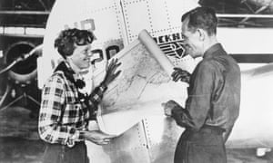 The pilot Amelia Earhart and her navigator, Fred Noonan, with a map of the Pacific that shows the route of their last flight in 1937. The quest to find her plane has led to attempts to map the seabed.