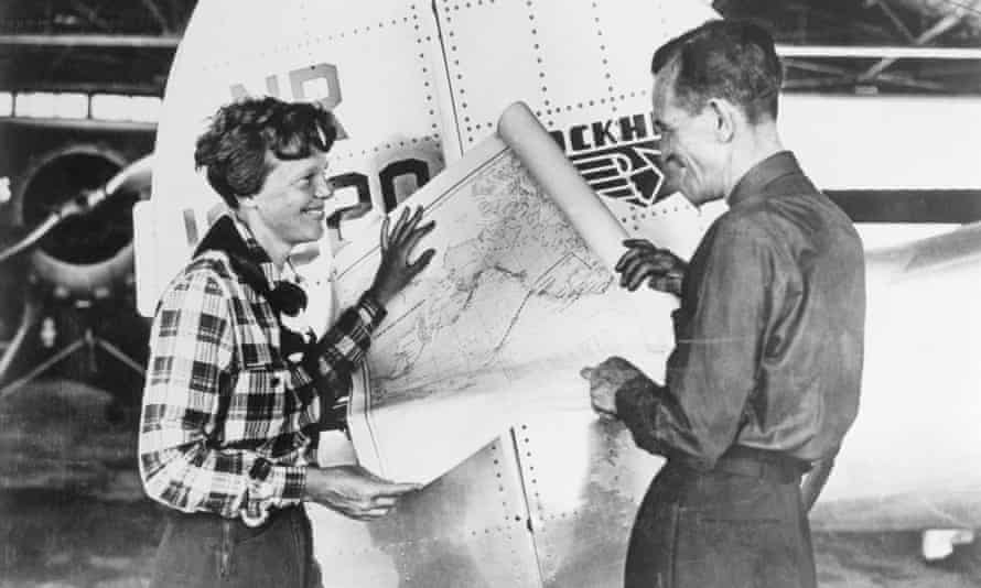 Earhart and Noonan, with a map of the Pacific that shows the planned route of their last flight.