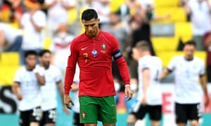 Cristiano Ronaldo (C) of Portugal reacts as German players celebrate their 1-1 equalizer.