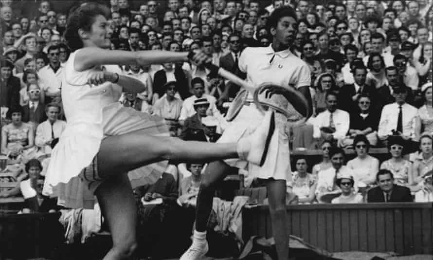 Angela Buxton, left, and Althea Gibson playing on centre court at Wimbledon in 1956.