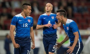 Bobby Wood celebrates with Morales and Bradley. The striker scored his second USA goal in two games.