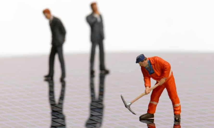 Figurines of a construction worker and two businessmen