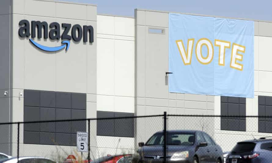 A banner encouraging workers to vote in labor balloting is shown at an Amazon warehouse in Bessemer, Alabama.