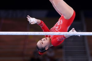 Fan Yilin of China tries to grab hold during the uneven bars final.
