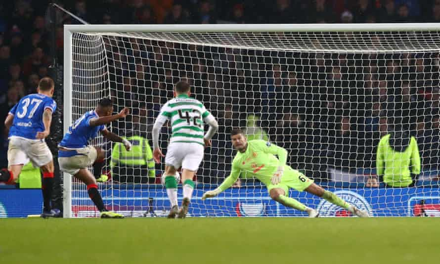 Celtic's Fraser Forster dives to his right to deny  Alfredo Morelos of Rangers from the penalty spot during the Scottish League Cup final.