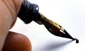 Person holding a fountain pen