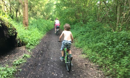 Family cycling along the Downs Link.