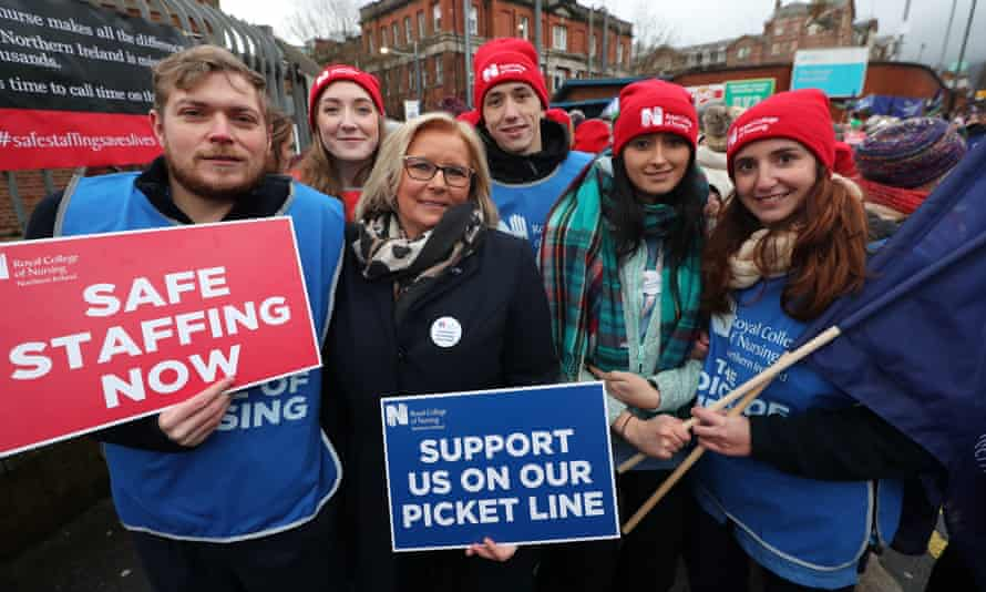 RCN NI director Pat Cullen (centre) joins the picket line outside the Royal Victoria hospital in Belfast.