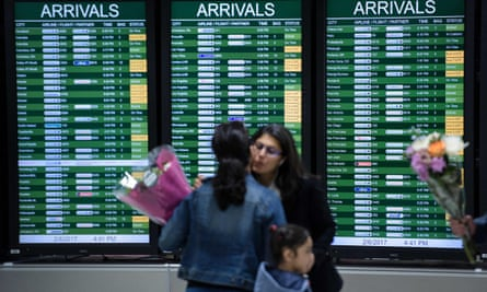 People arrive at Washington Dulles International Airport on 6 February.