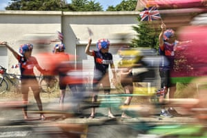 Cycling fans wave Union Jack flags during the 201km first stage between Noirmoutier-en-l'Île and Fontenay-le Comte