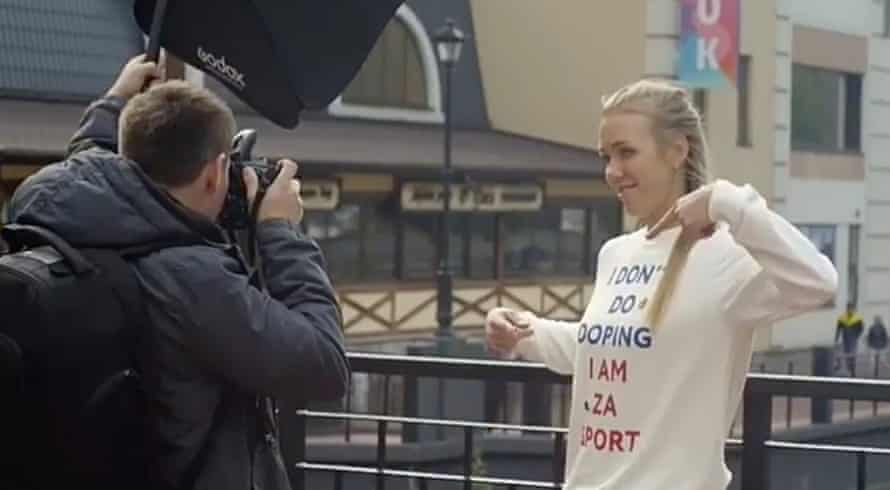Nadezhda Sergeeva points at the anti-doping shirt while filming the video