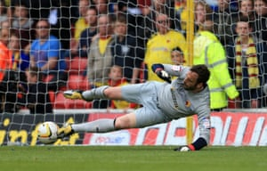 Manuel Almunia of Watford saves a penalty taken by Anthony Knockaert of Leicester City