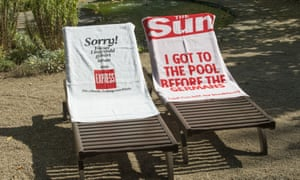 German and British tabloids the Express and the Sun compete in the beach lounger 'towel war'