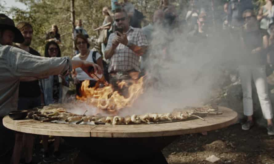 Festivalgoers gather round a firepit at Foodstock