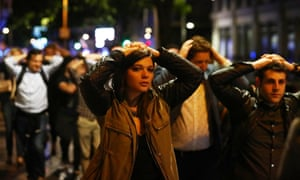 People leave the London Bridge area with their hands up after the 2017 terrorist attack