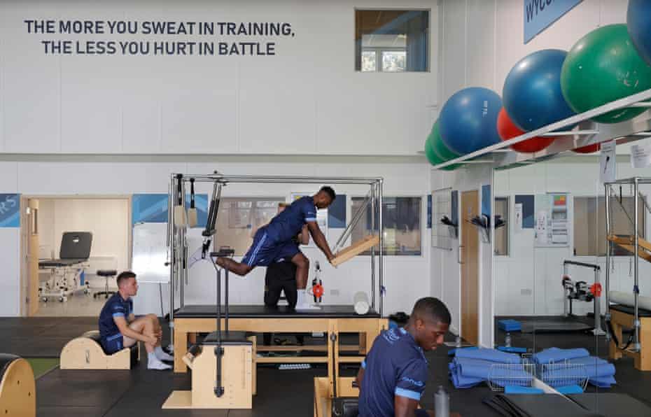 Left to right: Wycombe's David Wheeler, Brandon Hanlan and Sullay Kaikai prepare in the gym.