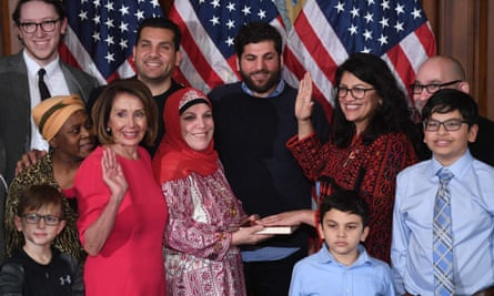 Rashida Tlaib with members of her family and Nancy Pelosi