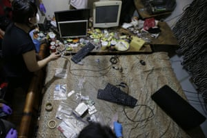 Members of the Philippines National Bureau of Investigation and the FBI gather evidence at the home of an American suspected of running an online child abuse operation during a raid in Mabalacat. The Philippines has emerged as a global hotspot for online child sexual exploitation, and coronavirus lockdowns that restrict millions to their homes may be worsening the abuses.