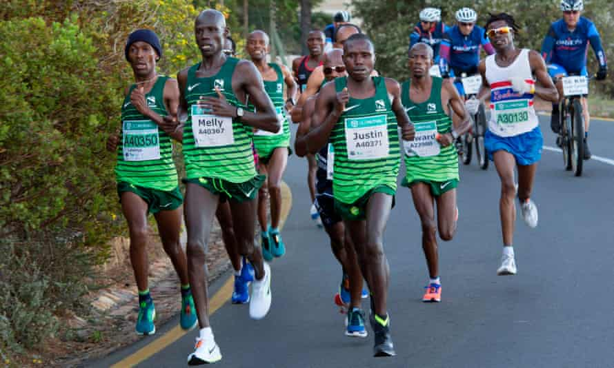 Runners, including eventual winner Justin Kemboi from Kenya, compete in the Two Oceans ultra-marathon in Cape Town in 2018.