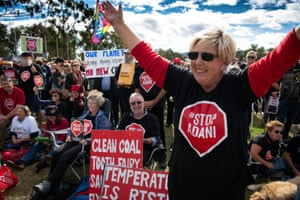 Members of the Stop Adani Convoy celebrate before the start of the Rally for Climate Change on the lawns of parliament House Canberra. The final stop of the Stop Adani Convoy.