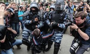 Police arrest a protester in Tverskaya Street, Moscow.