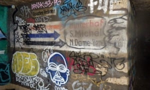 An old Nazi war bunker, covered in graffiti.