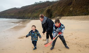 Carly White and her sons Harry, eight, and Finley, two, play on Carbis Bay beach