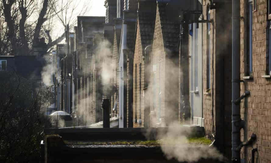 Residential dwellings exude steam in winter