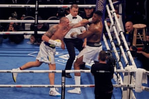 Oleksandr Usyk lands a left on Anthony Joshua in the final round.