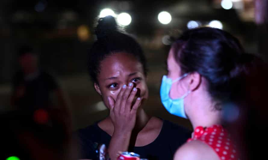 Adelana Akindes cries after she was released from jail in the wake of the shooting of Jacob Blake by police officers, in Kenosha, Wisconsin.