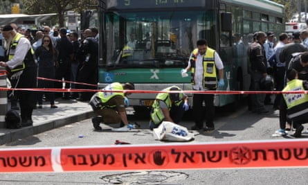 Israeli Zaka volunteers clean a site where a Palestinian man stabbed a 25-year-old Jewish man in Jerusalem.
