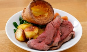 Traditional British Sunday lunch of roast beef and Yorkshire pudding.