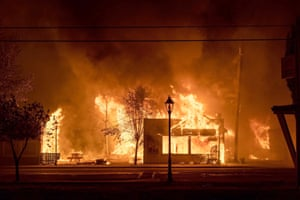 Buildings engulfed in flames as a wildfire ravages the central Oregon town of Talent near Medford