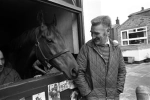 Red Rum and trainer Ginger McCain are pictured at his stable after winning the Grand National.
