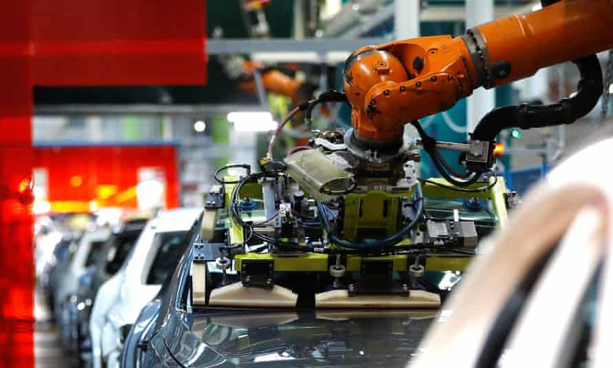 A robot adjusts a windscreen on the production line at the Daimler factory in Rastatt.