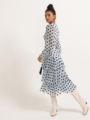 model wears polka-dot dress, £329, whistles.com. Boots, £119, zara.com. Heart earrings, £50, essentiel-antwerp.com.