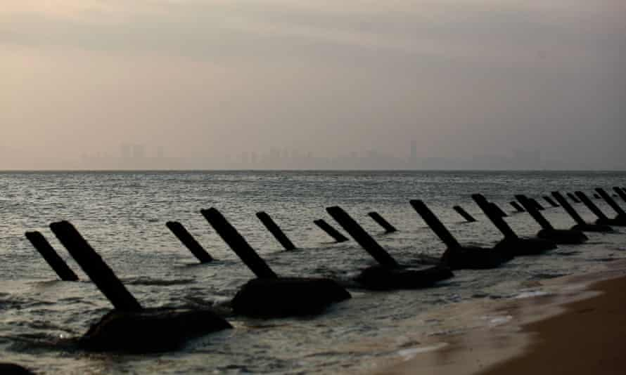 Anti-tank spikes line a beach at Cihu on the main island in Kinmen, a Taiwanese territory, with the Chinese city of Xiamen in the distance