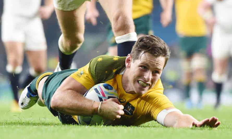 Australia's Bernard Foley shows his delight as he scores a try during the match against England