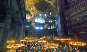 Muslims, wearing protective masks as a precaution against infection from coronavirus gather for the Eid al-Adha prayer inside the Byzantine-era Hagia Sophia, recently converted back to a mosque, in the historic Sultanahmet district of Istanbul, Friday, July 31, 2020.