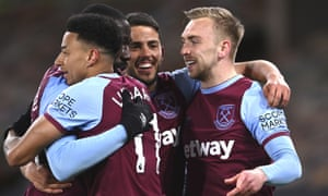 West Ham's Jarrod Bowen, right, celebrates with teammates after scoring his side's third goal.