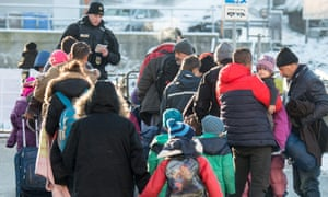 Migrants line up at Passau station in southern Germany.