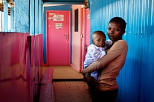 Celestine, 19, holds her son Raven at a health clinic in Kibera.