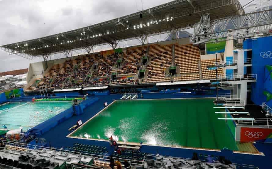 The water in the diving competition pool is green before the start of the Men's Synchronised 3m Springboard final.