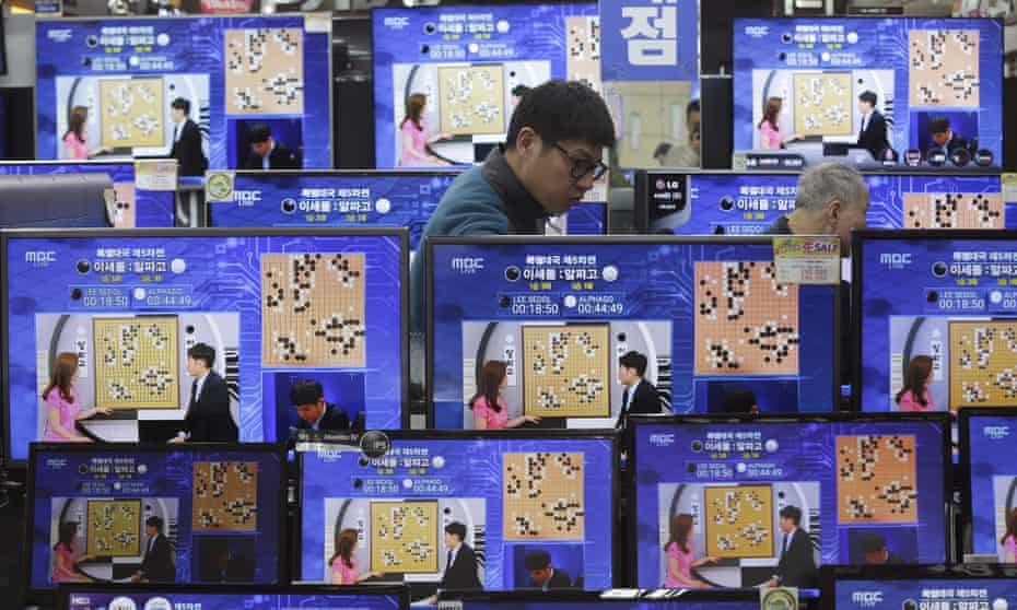 TV screens show the live broadcast of the Google DeepMind Challenge Match between Google's artificial intelligence program, AlphaGo, and South Korean professional Go player Lee Sedol, at the Yongsan Electronic store in Seoul, South Korea.