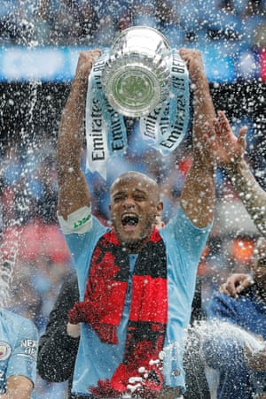 18 May 2019: Kompany lifts the FA Cup after Manchester City beat Watford 6-0, winning the trophy for the second time with the club.
