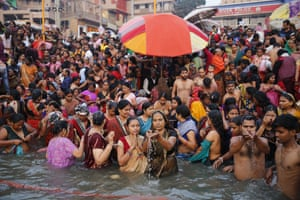 Varanasi, India Hindus crowd the bank of the river Ganges to take dips and offer prayers during Karthik Purnima festival
