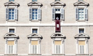 Pope Francis celebrates the Angelus prayer from a window of his rooms in the Vatican