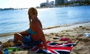 English girl with union jack towel in Ibiza