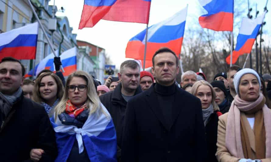 Russian opposition leader Alexei Navalny and Lyubov Sobol (left) at a protest in February.