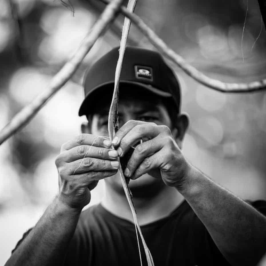 Kyle begins braiding bark into rope